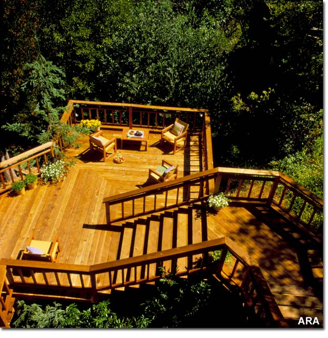 Elevated deck with stairs and hand rails made with red cedar