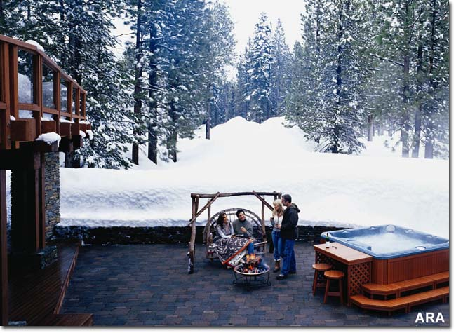Enjoying the winter in an outdoor hot tub