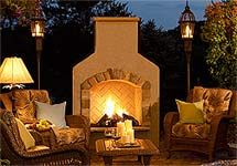 Cozy outdoor wood fireplace on the patio