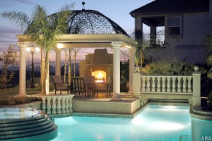 A patio with a nice view, pool and warm fireplace