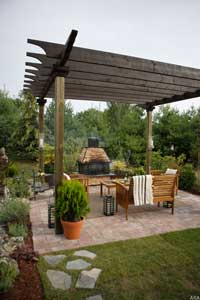 Wood pergola on brick patio